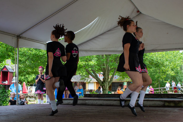 The step dancers take to the stage