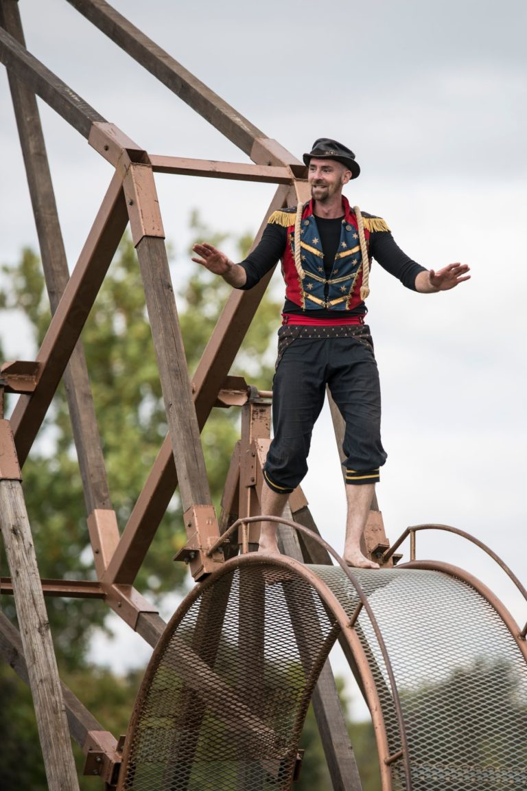 Witness the amazing Ichabod Wainwright mesmerize audiences with death defying feats on The Wheel of Death.